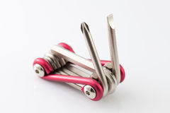 Screwdrivers multi tool on white background Royalty Free Stock Photo