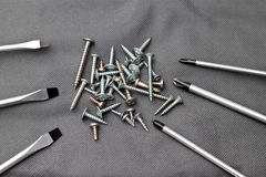 Screwdrivers and nails Stock Photo
