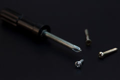 Screwdrivers and nut screws placed side. Low key Tools on darkness background royalty free stock photo