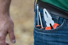 Screwdrivers in the pocket of a blue jeans royalty free stock photography