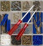 Screwdrivers, screws and dowels Stock Photos