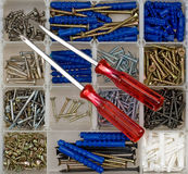 Screwdrivers, screws and dowels Stock Photos