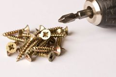 Screwdrivers and screws on a white background. The concept of work. Labor day royalty free stock image
