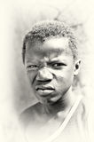 Screwed face of a Ghanaian boy Stock Photo