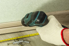 Screwing Chipboard. close-up Stock Image