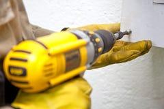 Screwing with a drill. Man screwing with a drill Stock Photography