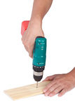 Screwing with an electric screwdriver Stock Photography