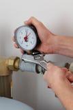 Screwing pressure gauge stock photo