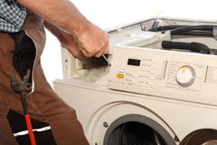 Screwing on washer. Worker is screwing a washer on white background Royalty Free Stock Photos