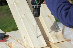 Screwing of wooden beams. Screwing of wooden construction beams Royalty Free Stock Image