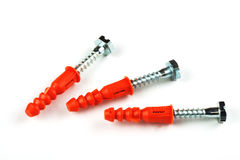 Screws. And orange kapron inserts on a white background Royalty Free Stock Photos
