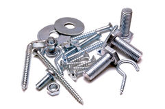 Screws. Group of screws,nuts and shims over white background Stock Photos