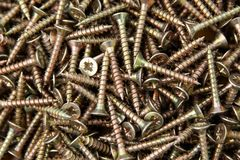 Screws. The background consisting of metal chromeplated screws Stock Photos