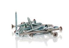 Screws. A closeup of some long metal screws in a heap stock image