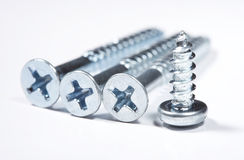 Screws. Silvery screws lie on a white background Royalty Free Stock Image