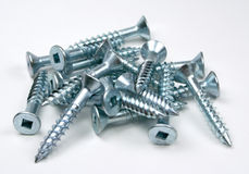 Screws. A pile of silver screws stock image