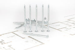 Screws and arhitectural sketch Royalty Free Stock Images