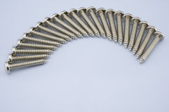 Screws arranged. Screws, a straight line can be placed in a semicircle. The sun seemed Stock Image