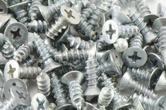 Screws. Background of small screws stock images