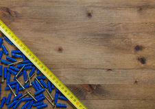 Screws with blue dowels tape measure Stock Image