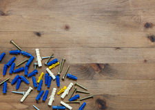 Screws with blue and yellow dowels Royalty Free Stock Images