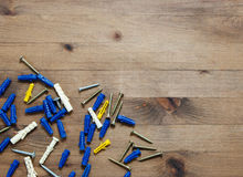 Screws with blue and yellow dowels Royalty Free Stock Photo