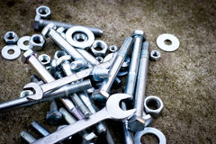 Screws, bolt, metal nuts, canvas, wrench to unscrew Royalty Free Stock Image