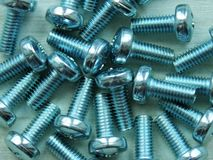 Screws and bolts close-up texture royalty free stock photography