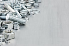 Screws and bolts of different size for house renovation on scrat Royalty Free Stock Image
