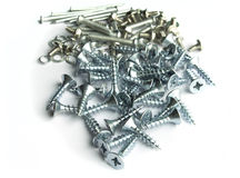 Screws, bolts, nails and different type of metal on white backgr Stock Photo