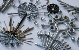 Screws, bolts, nails, dowels, rivets, nuts,