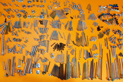 Screws, bolts, nuts, fasteners on orange Stock Photo