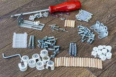 Screws,bolts and other construction elements  background. Screws,bolts and other construction elements on a wooden background Royalty Free Stock Images