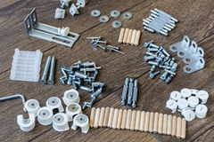 Screws,bolts and other construction elements  background. Screws,bolts and other construction elements on a wooden background Stock Photos