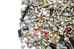 Screws and bolts on white background. Royalty Free Stock Photos