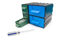 Screws box with drawers. And screwdriver Royalty Free Stock Photography