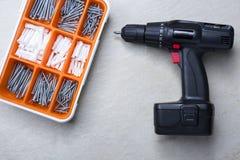 Screws box and screwdriver Royalty Free Stock Photo