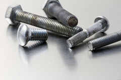 Screws on brushed metal Royalty Free Stock Photography