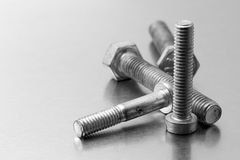 Screws on brushed metal Royalty Free Stock Photo