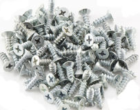 Screws. Closeup on a white background royalty free stock images