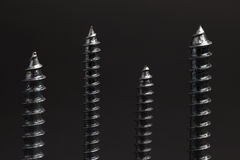 Screws in the dark Stock Image