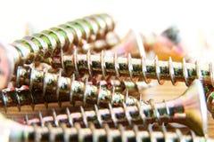 Screws. Detail disordered screws, screws at the meeting Royalty Free Stock Photo