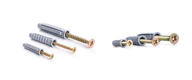 Screws and dowels on a white background Stock Photos