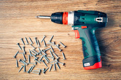 Screws fasteners and electric screwdriver Royalty Free Stock Images