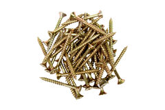 Screws gold-colored. On white background, tools for mounting threaded which are screwed into the holes Royalty Free Stock Photo
