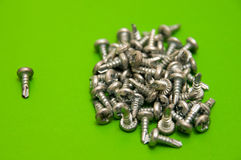 Screws on Green Stock Photos