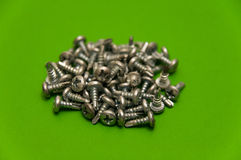 Screws on Green Stock Image