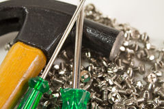Screws, hammer and screwdriver stock image