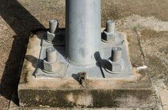 Screws hold a pole Stock Photos