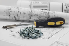 Screws lie on the blueprint Royalty Free Stock Photos
